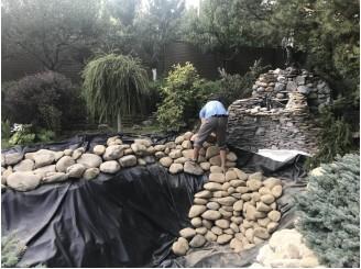 Реконструкция изоляции водоема для карпов КОИ, облицовка камнем с. Дмитровка